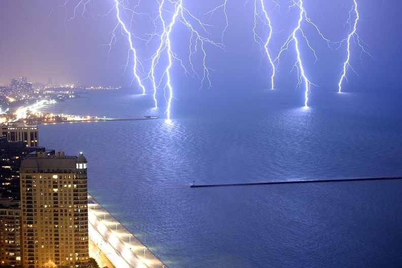 six lightning strikes captured at once on lake michigan
